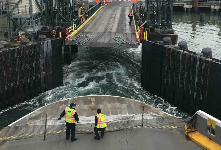 Bainbridge ferry docking in Seattle by Ray Monde