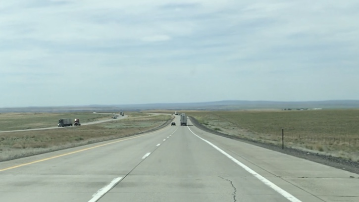 Highway in Idaho with flat plains by Ray Monde