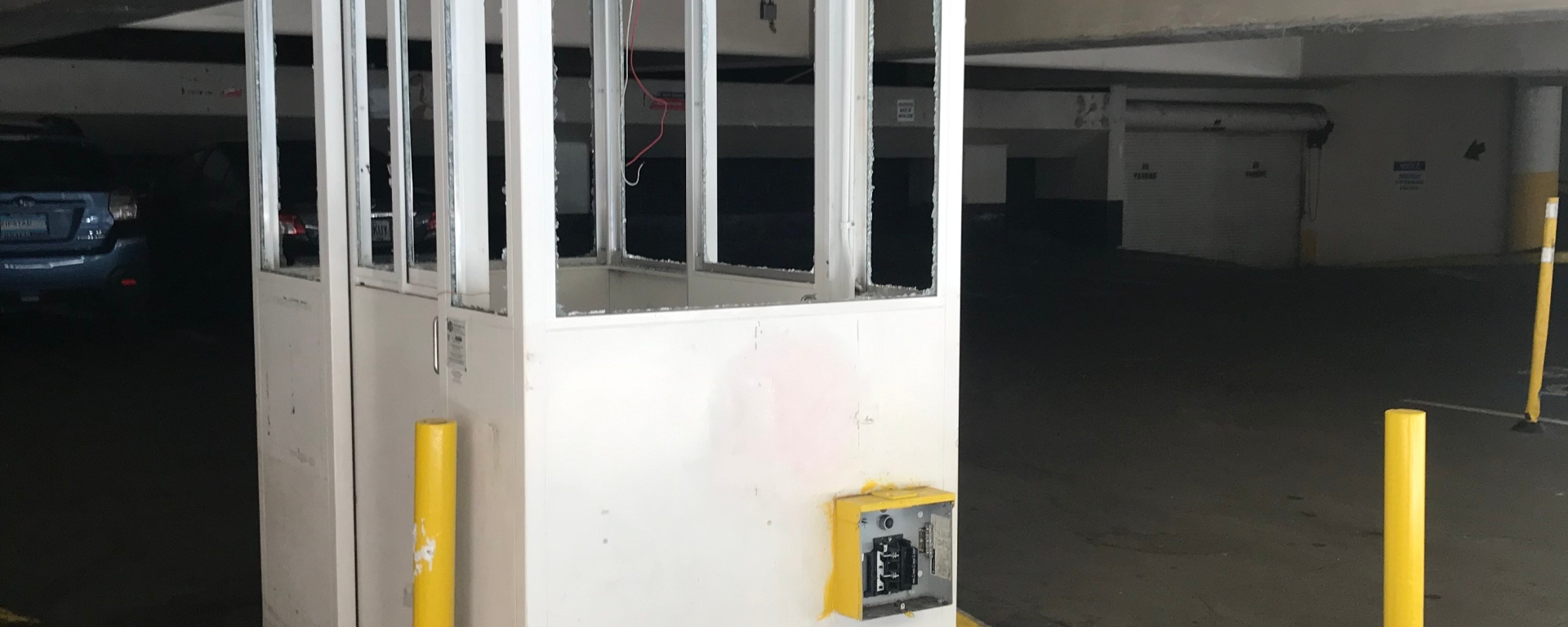 Car park booth with smashed windows