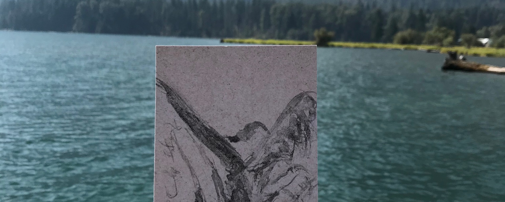 sketch in charcoal of glacial lake by Ray Monde