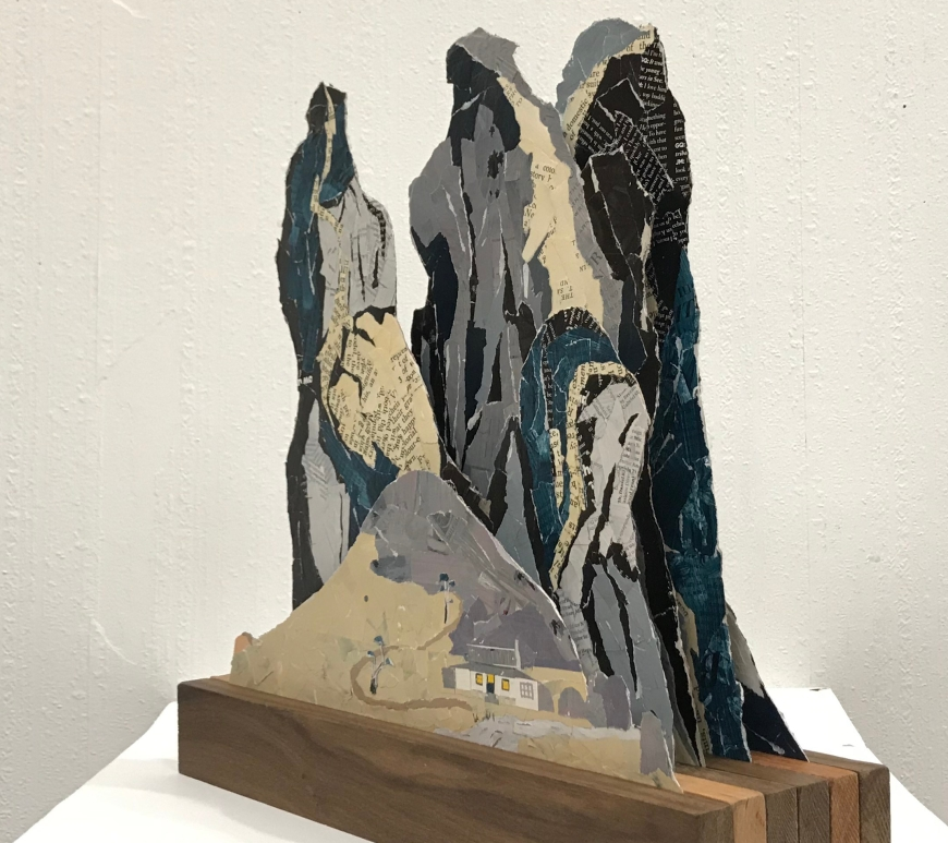 Paper and wood sculpture of mountains