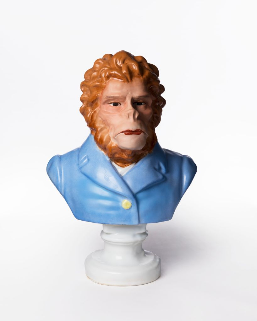 Porcelain bust of ape with lipstick by Phil James